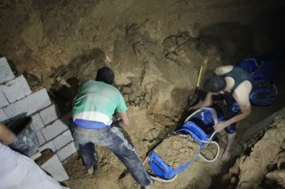 A group of tunnel workers are manually digging to rebuild a tunn