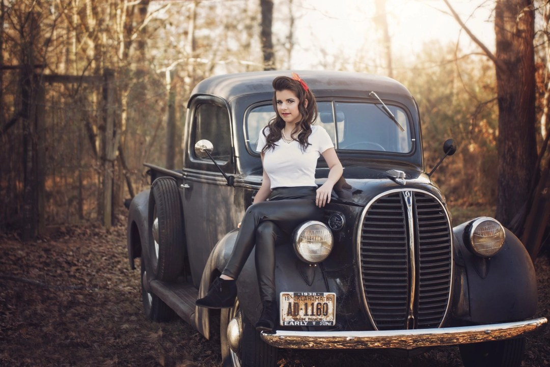 senior posing on vintage car in outdoor photo session