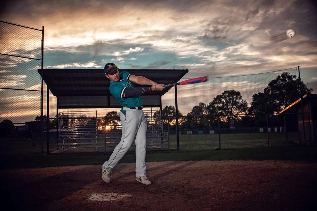 creative senior photo shoot of high school athlete baseball player action shot