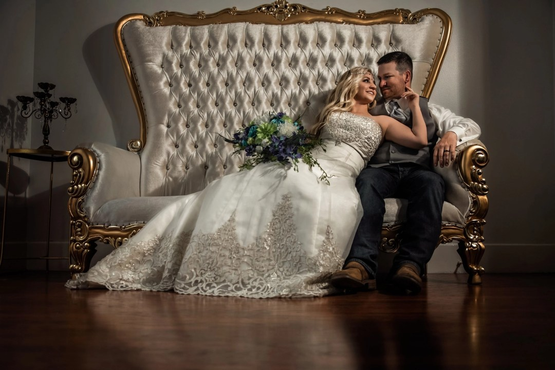 bride and groom on white and gold chair at the secret garden sulphur louisiana