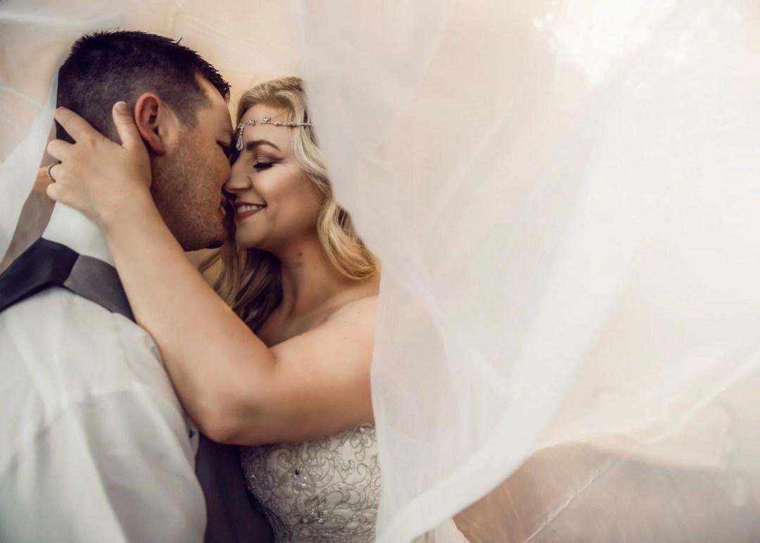 close up wedding day kiss