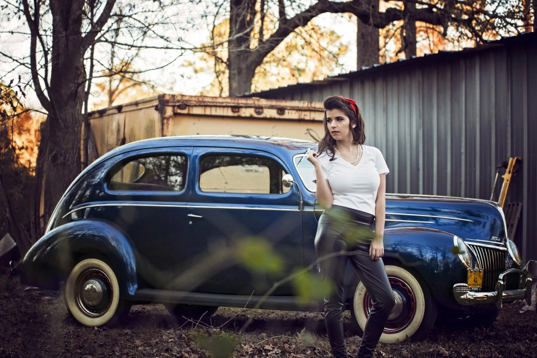 high school senior portrait near vintage car