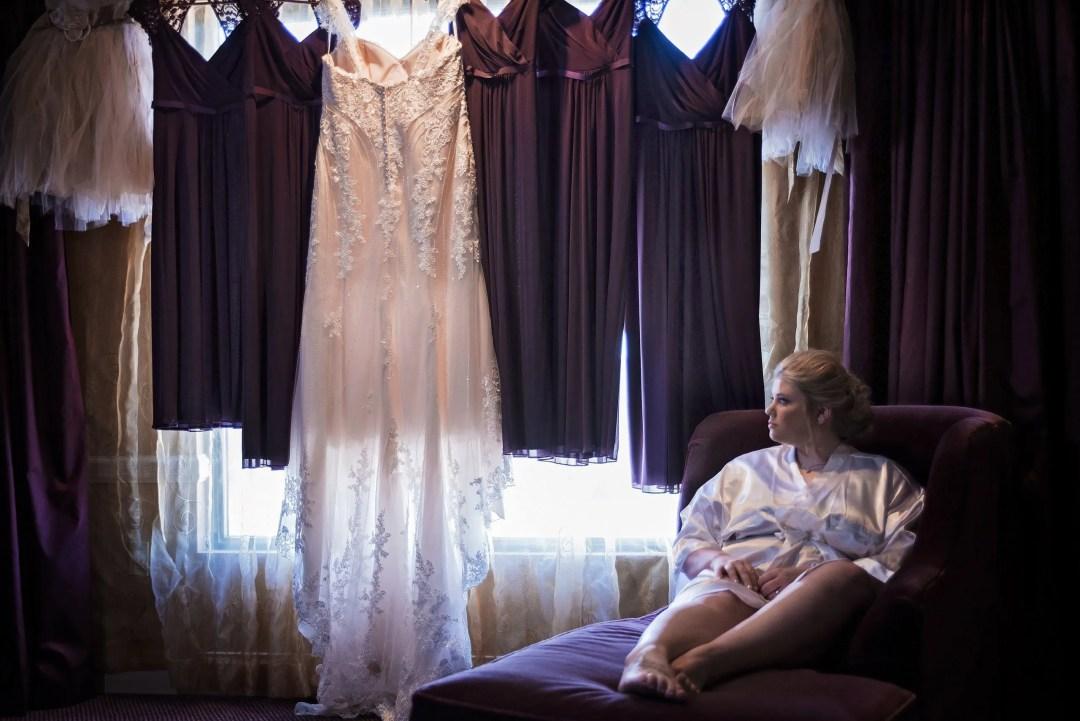 blonde bride gazing at wedding dresses on her big day