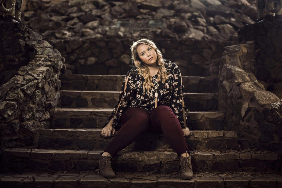 blonde senior portrait on steps at jungle gardens avery island