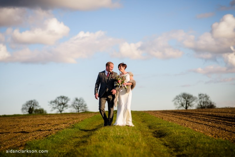 bride and groom photos in a field in summer