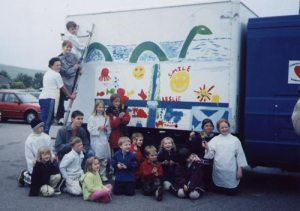 Aberdeenshire children painting a truck before departure