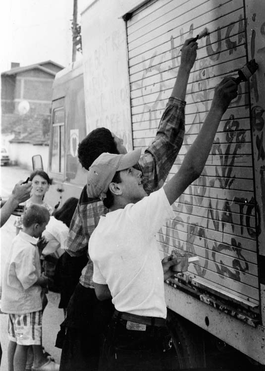 Kids in Prishtina painting truck
