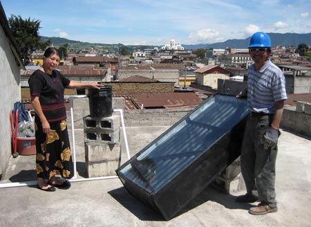 Papa Carlos & Mama Coney with a UCB Batch Solar Water Heater installed on their roof in Guatemala