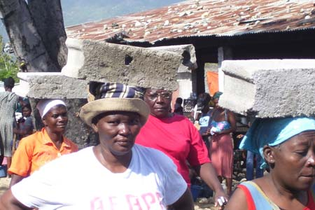 Women of AFAPA (Association des Femmes Active de Petite Anse) help build the latrine.