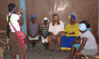 Peter Haas and Gerthy Lahens speak to the women of the Petite Anse peanut butter cooperative