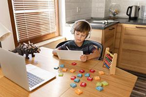 long-shot-child-attending-virtual-school-courses_23-2148766756