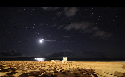 Maui moon over beach at night