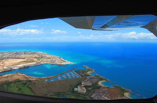 Plane landing in Hawaii from mainland USA.