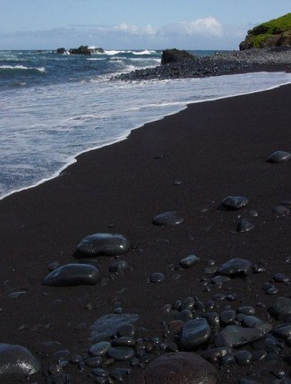 This is a black sand beach located close to Hana, Maui.