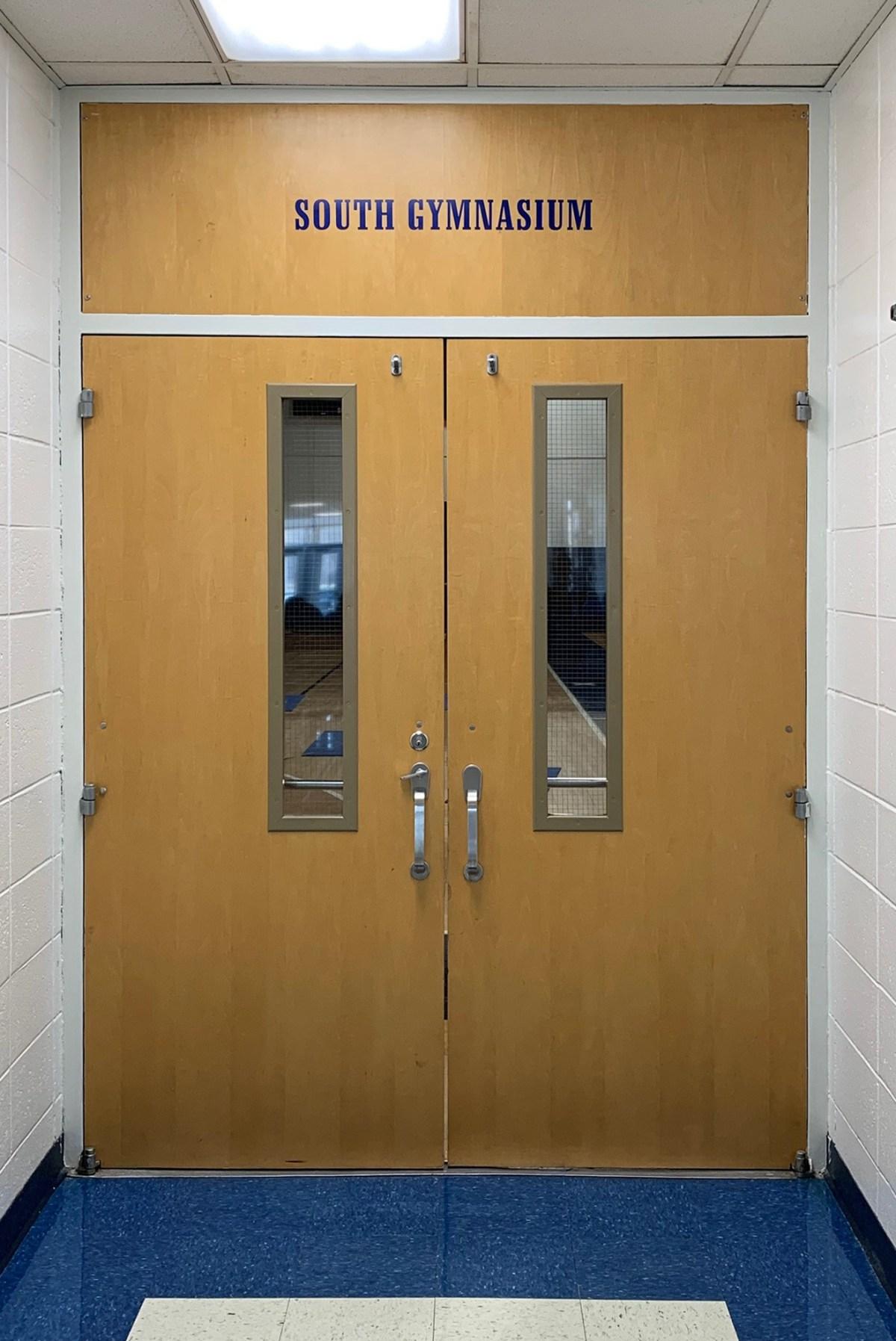 Lisle gym door before installation