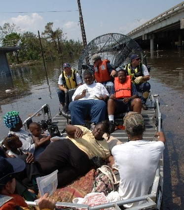 An airboat pulls up to the Memorial Medical Center in New Orleans on Wednesday, Aug. 31, 2005. Floodwaters continued to rise in the Crescent City after several levees broke, inundating the city in the wake of Hurricane Katrina. photo: Jocelyn Augustino/FEMA