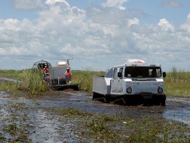 Sudan - airboat following marsh buggy