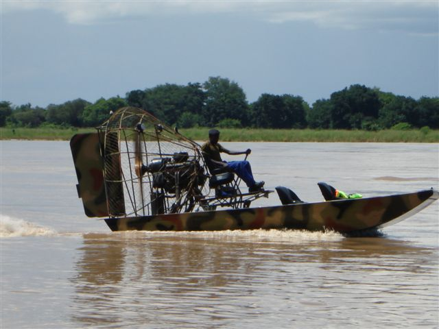 ZAWA - Zambia Wildlife Authority - officers patrol the South Luangwa National Park with an airboat.