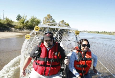 Deputy David Long (left) takes Daniela Medrano, the public relations officer for the Tulsa County Sheriff's Office, along for a test ride on the Arkansas River in the department's new air boat Wednesday. CORY YOUNG / Tulsa World