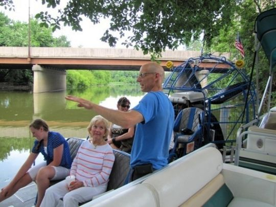 Mike Gasdorf rolls down the river to The Deck, the outdoor section of Hall's Old Gas House, to pick up airboat riders.