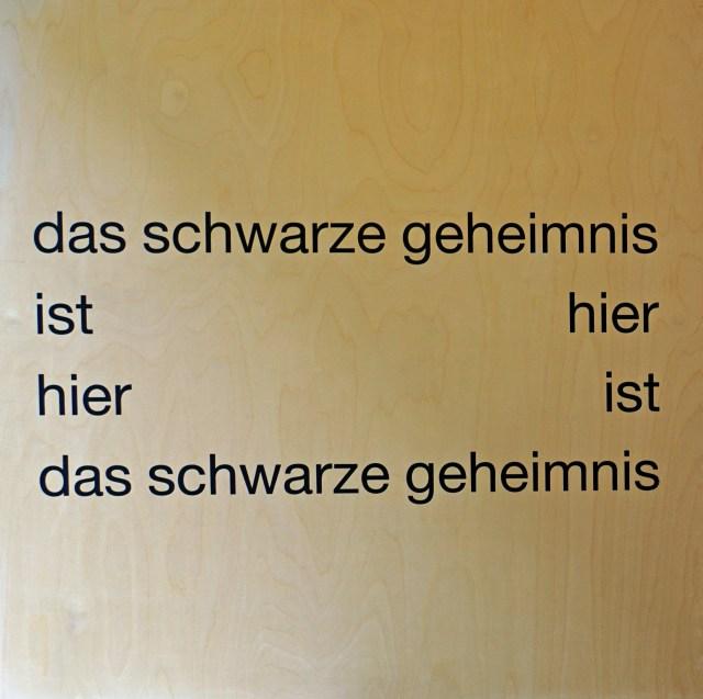 eugen gomringer - das schwarze geheimnis - 70x70x8 cm - textdruck auf holz - 2005