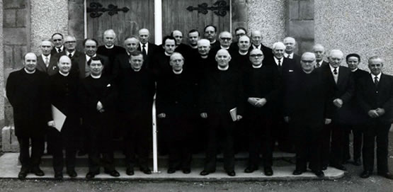 Donald in his younger days with the brethren at the induction of a colleague.