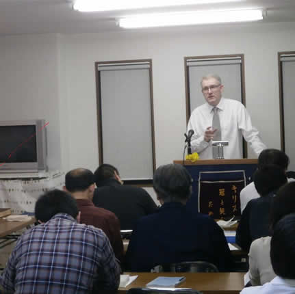 Rev. Quigley lecturing at the Kobe Theological Hall.