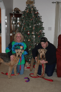 Paris Airedale with her adopted family at Christmas