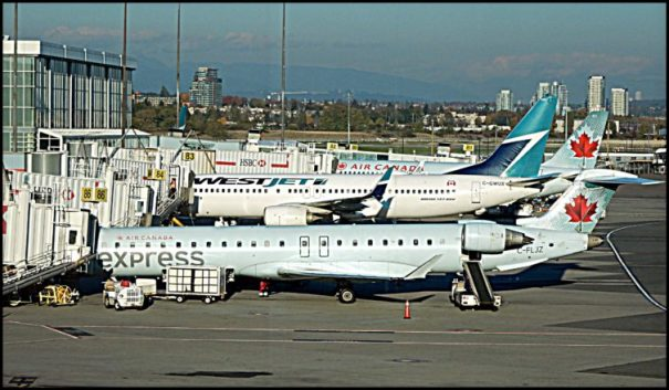 A collection of aircraft lined up for departure at YVR.