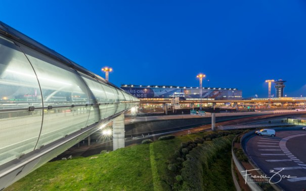 The Orly Airport terminal features a futuristic-looking pedestrian walkway