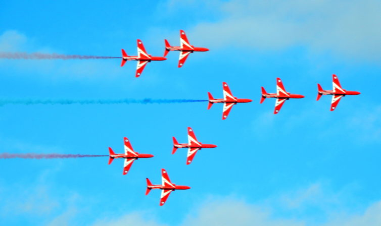 """One Aircraft Short: The Red Arrows seen performing their """"Concorde"""" maneuver."""