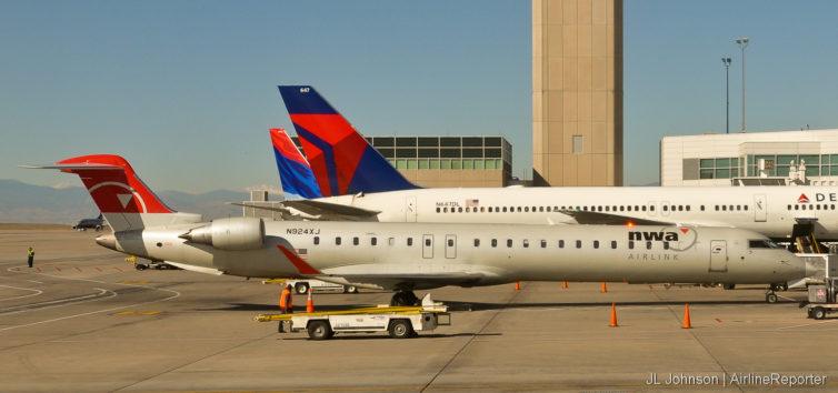 N924XJ, a Northwest CR-9 accompanies some Delta birds in Denver.
