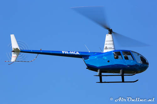 PH-HCA Robinson R44 Raven II (rechts felblauw)