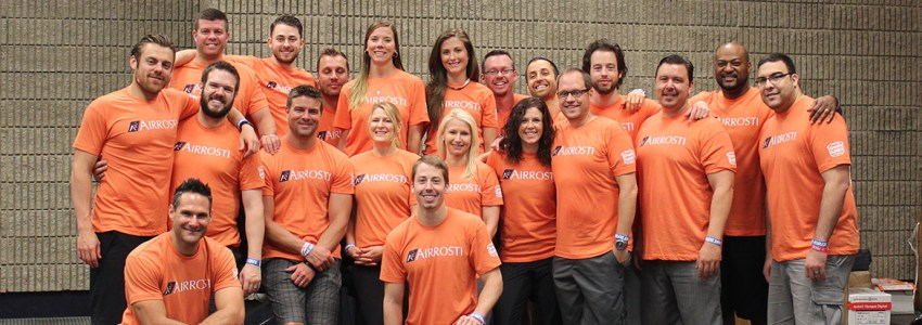 several men and women photographed in a picture together with shirts that say airrosti
