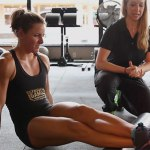 Stacie Tovar foam rolling ankles and calves.