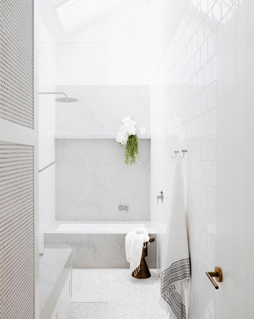 white vanity white bathroom tiles