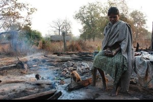 an-adivasi-woman-in-her-burnt-house-in-dantewada