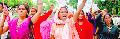 Women protestors raising slogans