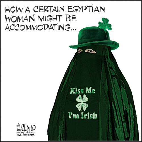 """Aislin cartoon with Arab woman in green niqab with a hat and 3-leaf-clover, with the words, """"Kiss me, I'm Irish"""" on the front of the niqab."""