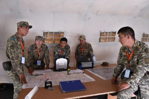 Kazakh soldiers discuss operaitons during phase two of Steppe Eagle 15. Soldiers from eight countries, participated in a command post exercise focused on staff planning using the Military Decision Making Process.