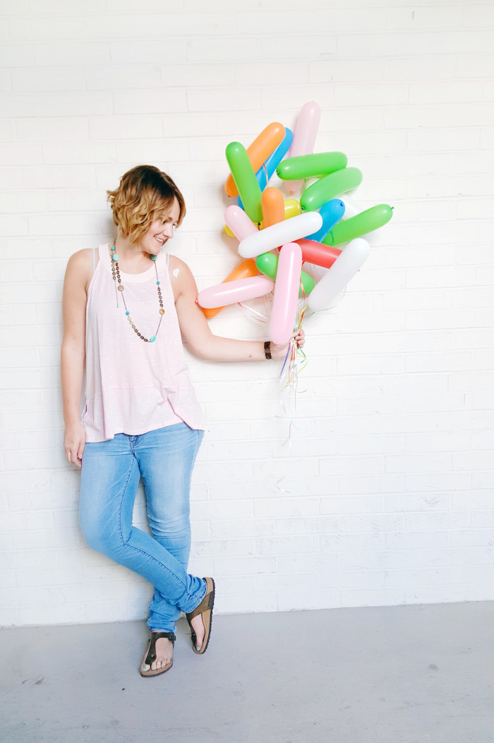 Fill long balloons and apply the string to different areas so they look like a cute bundle of sprinkles! Perfect for a sprinkle party | A Joyful Riot