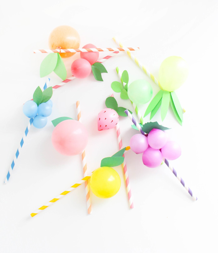Sweet and colorful fruit balloon straws for your summer parties! Lemons, limes, pineapples, strawberries, cherries, peach, orange, grapes, blueberries! via A Joyful Riot-40