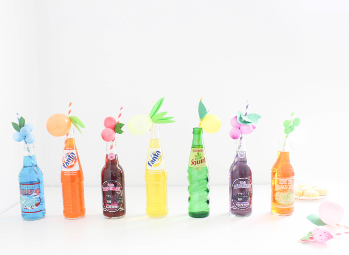 Sweet and colorful fruit balloon straws for your summer parties! Lemons, limes, pineapples, strawberries, cherries, peach, orange, grapes, blueberries! via A Joyful Riot-43