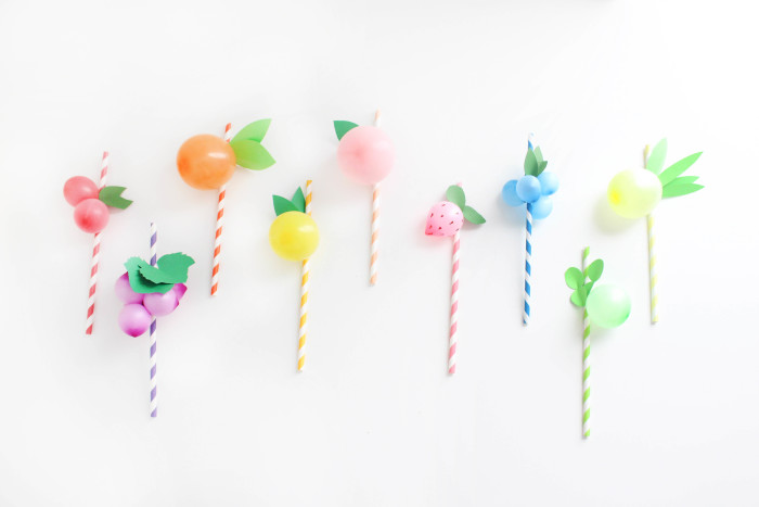 Sweet and colorful fruit balloon straws for your summer parties! Lemons, limes, pineapples, strawberries, cherries, peach, orange, grapes, blueberries! via A Joyful Riot-44