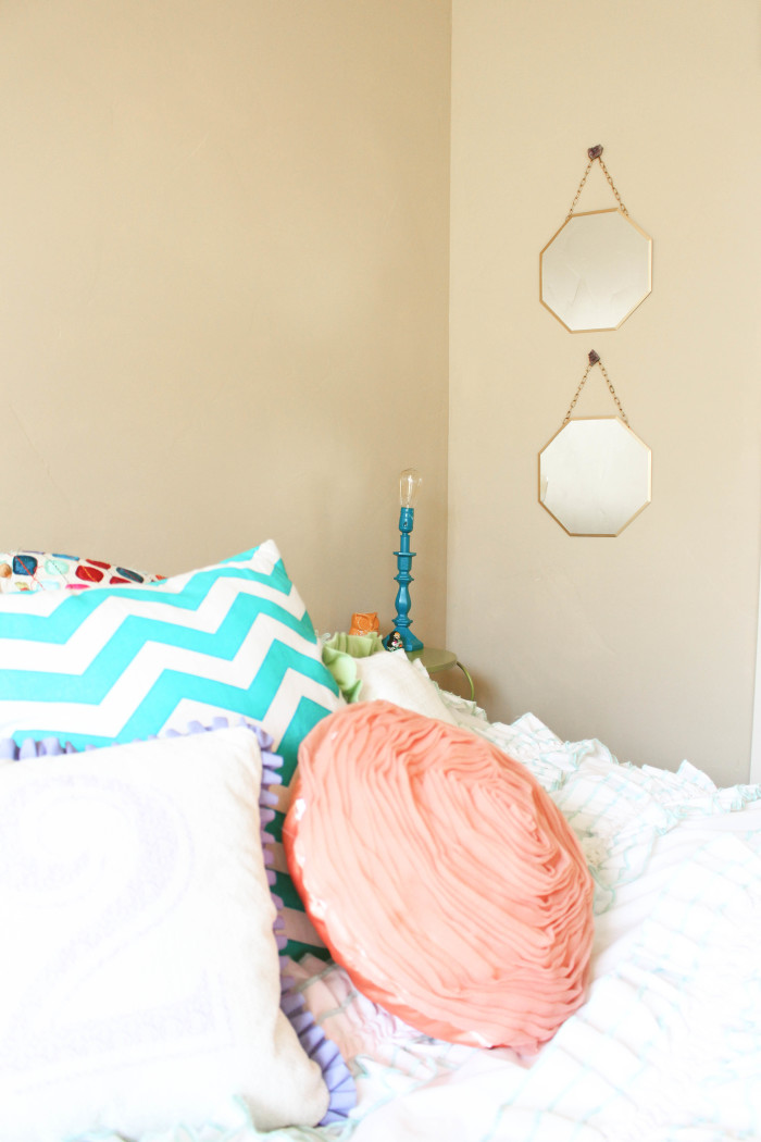 A little spray paint and some chain makes simple mirrors a real beautiful accent piece | A Joyful Riot