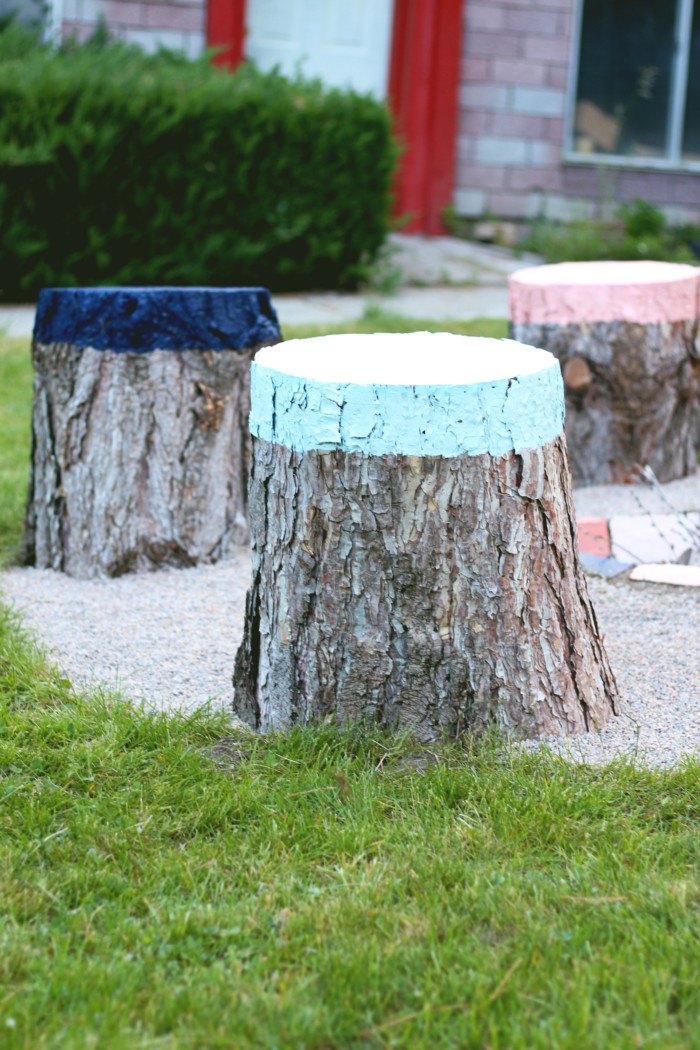 Paint stumps for awesome outdoor seating or tables via ajoyfulriot.com