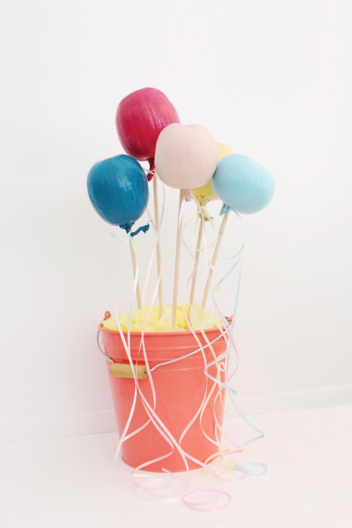 Make your halloween pumpkins look like balloons for a whimsical take on your fall decor! | Balloon pumpkins via A Joyful Riot