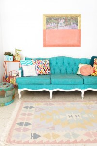 Bright & colorful boho entryway with turquoise couch