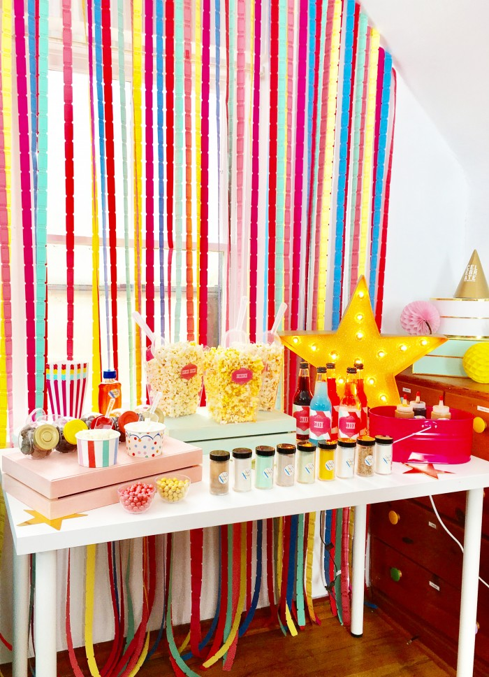 A colorful movie night with popcorn bar!