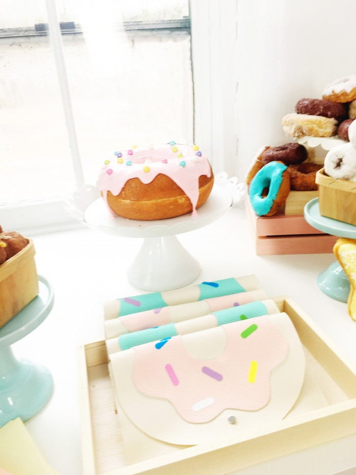 pastel donut party with giant donut cake and DIY donut clutches!